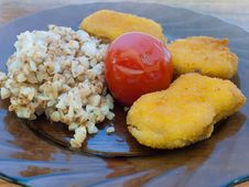 Free Buckwheat Porridge With Chicken Nuggets And Tomato Royalty Free Stock Photography - 24603607