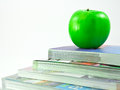 Free Books And An Apple Stock Photos - 24616563