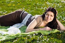 Free Beautiful Girl Lying On The Grass With Flowers Royalty Free Stock Photography - 24639227