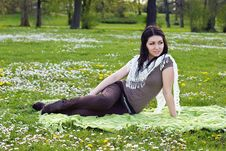 Free Beautiful Girl Sitting On The Plaid In The Park Royalty Free Stock Image - 24639296