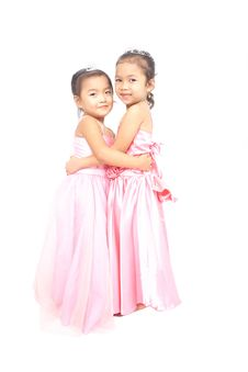Free Two Asian Girls In Pink Dress Hugging Each Other Stock Photo - 24641030