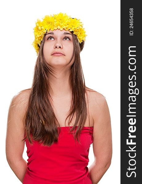 Girl in daisy wreath looking up