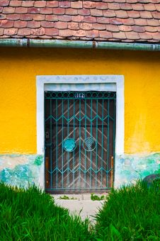 Free Locked Door And Colorful Yellow Wall Royalty Free Stock Image - 24660416