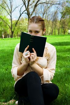 Free Girl In The Park With A Book Stock Photos - 24660563