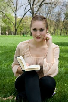 Free Woman Lies On Green Grass And Reads Book Stock Image - 24660901