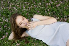 Free Girl Lying On Green Grass With Flowers Royalty Free Stock Photo - 24661305