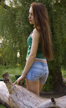 Free Girl In A Blouse And Shorts, Enjoying The Spring Stock Photos - 24661413