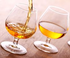 Pouring Cognac Into The Glass Stock Images