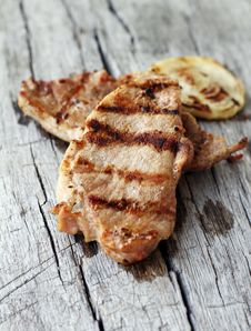 Free Grilled Steak On Wooden Table Stock Image - 24671041
