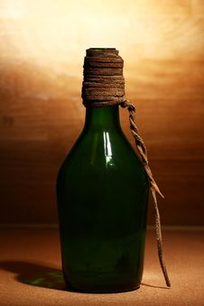 Free Old Bottle Over Wooden Surface Royalty Free Stock Photos - 24671088