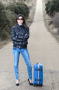 Free Woman In Lonely Road With Suitcase Royalty Free Stock Photography - 24688867
