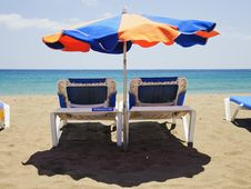 Free Beach Umbrella And Deckchairs Royalty Free Stock Image - 24689346