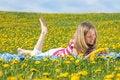 Free Teenage Girl Lying On A Dandelion Field Stock Photos - 24694573
