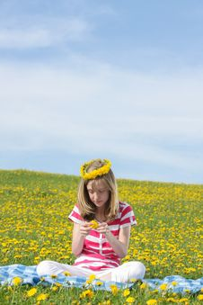 Free Teenage Girl Sitting On A Dandelion Field Stock Photo - 24694550