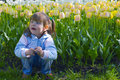 Free Thoughtful Girl In Tulips Royalty Free Stock Photography - 2475567