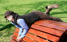 Free Girl Having Fun On Wooden Seat Stock Photography - 2471792