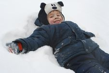 Free The Boy Lays On A Snow Royalty Free Stock Photos - 2478328