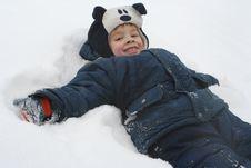 The Boy Lays On A Snow Royalty Free Stock Photos