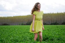 Blonde Girl Laughing In A Meadow Stock Photography