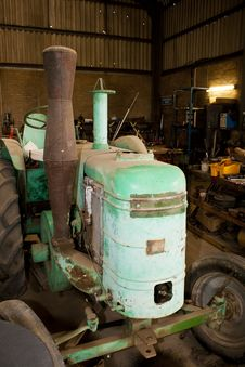 Free Vintage Tractor In Workshop Stock Image - 24704121