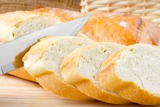 Free Freshly Baked Baguette Sliced On Cutting Board Royalty Free Stock Photos - 24704568