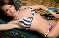 Free Woman Lying Lounge Chair Sunbathing Bamboo Stock Photography - 24708162