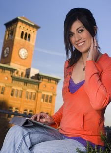 Woman Using A Computer Tablet Outside Downtown Stock Photography