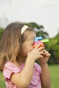 Free Girl Playing Outdoors With Constructor Royalty Free Stock Image - 24714116
