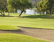 Free Golf Course With Sandtrap And Lake Stock Photos - 24715043