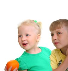 Brother And Sister, And An Isolated Orange Stock Photography