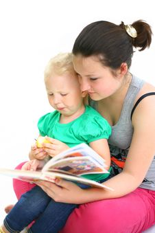Free Nurse The Child Reads A Book Royalty Free Stock Photos - 24715538