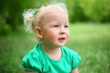 Free Child Is Sitting On The Grass Royalty Free Stock Photography - 24715647