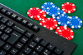 Free Fragment Of Black Keyboard With Gamble Chips. Royalty Free Stock Images - 24724069