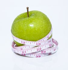 Free Green Apple And Tape Measure Stock Images - 24723874