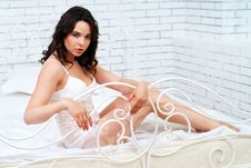 Free Lovely Brunette Posing In A Bedroom Stock Photography - 24726282