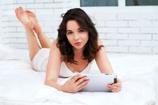 Free Beautiful Young Woman Using Tablet Computer Stock Image - 24727601