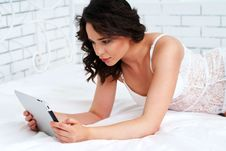 Beautiful Young Woman Using Tablet Computer Stock Image