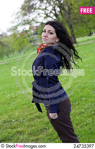 Free Carefree Young Woman In Park Royalty Free Stock Photography - 24735397