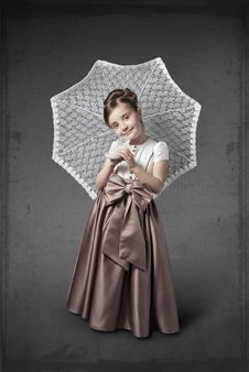 Free Girl In A Luxurious Dress With An Umbrella Royalty Free Stock Image - 24735126
