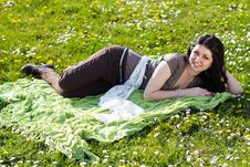 Free Beautiful Girl Lying On The Grass With Flowers Stock Image - 24735131