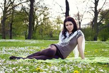 Free Beautiful Girl Sitting On The Plaid In The Park Royalty Free Stock Photography - 24735177