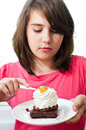 Free Portrait Of Young Woman Eating Cake Isolated On Wh Royalty Free Stock Photography - 24749817