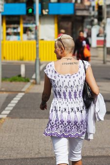 Free Tattooed Woman Crossing A Road Stock Image - 24743451