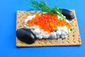 Free Crackers With Cream Cheese Red Caviar And Olives Royalty Free Stock Photography - 24758767