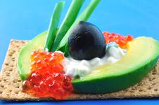 Free Crackers With Avocado, Caviar And Olives Stock Photos - 24758643