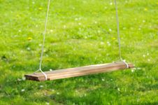 Free Empty Wooden Swing In The Garden Royalty Free Stock Photo - 24766525