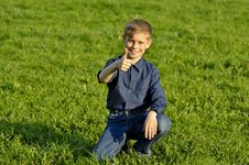 Free The Happy Child On A Green Grass Stock Photos - 24768203