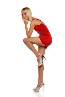 Free Young Blond Woman Wearing A Red Dress Stock Photos - 24770903