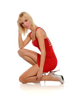 Free Young Blond Woman Wearing A Red Dress Royalty Free Stock Images - 24770919