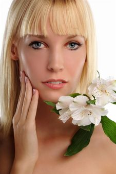 Free Young Blond Woman Holding Lillies Royalty Free Stock Images - 24771199